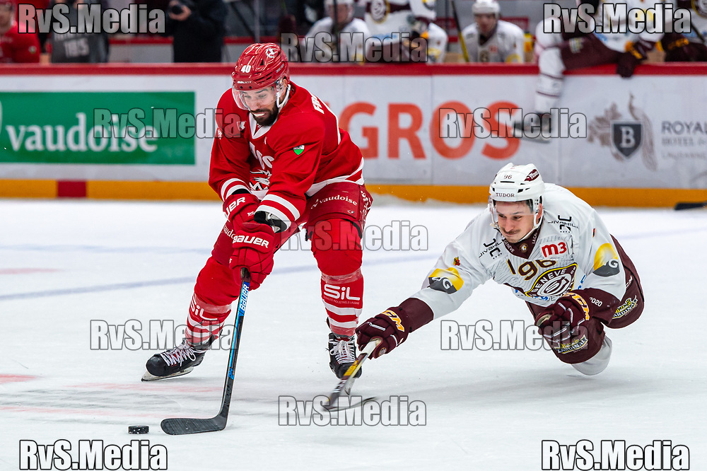 LAUSANNE, SWITZERLAND - NOVEMBER 23: #96 Noah Rod of Geneve-Servette HC battles for the puck with #40 Etienne Froidevaux of Lausanne HC during the Swiss National League game between Lausanne HC and Geneve-Servette HC at Vaudoise Arena on November 23, 2019 in Lausanne, Switzerland. (Photo by Monika Majer/RvS.Media)
