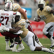 South Carolina Gamecocks cornerback Victor Hampton (27) gets tackled by UCF Knights running back William Stanback (28) after an interception, during an NCAA football game between the South Carolina Gamecocks and the Central Florida Knights at Bright House Networks Stadium on Saturday, September 28, 2013 in Orlando, Florida. (AP Photo/Alex Menendez)