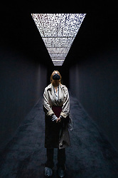 """© Licensed to London News Pictures. 17/05/2021. LONDON, UK. A woman views """"data.flux [no. 1]"""", 2020, by Ryoji Ikeda. Preview of Ryoki Ikeda's exhibition at 180 The Strand, the largest ever European exhibition of the Japanese artist's work.  Twelve audio-visual digital artworks, five of which have never been seen before, are on show 20 May to 1 August 2021.  Photo credit: Stephen Chung/LNP"""