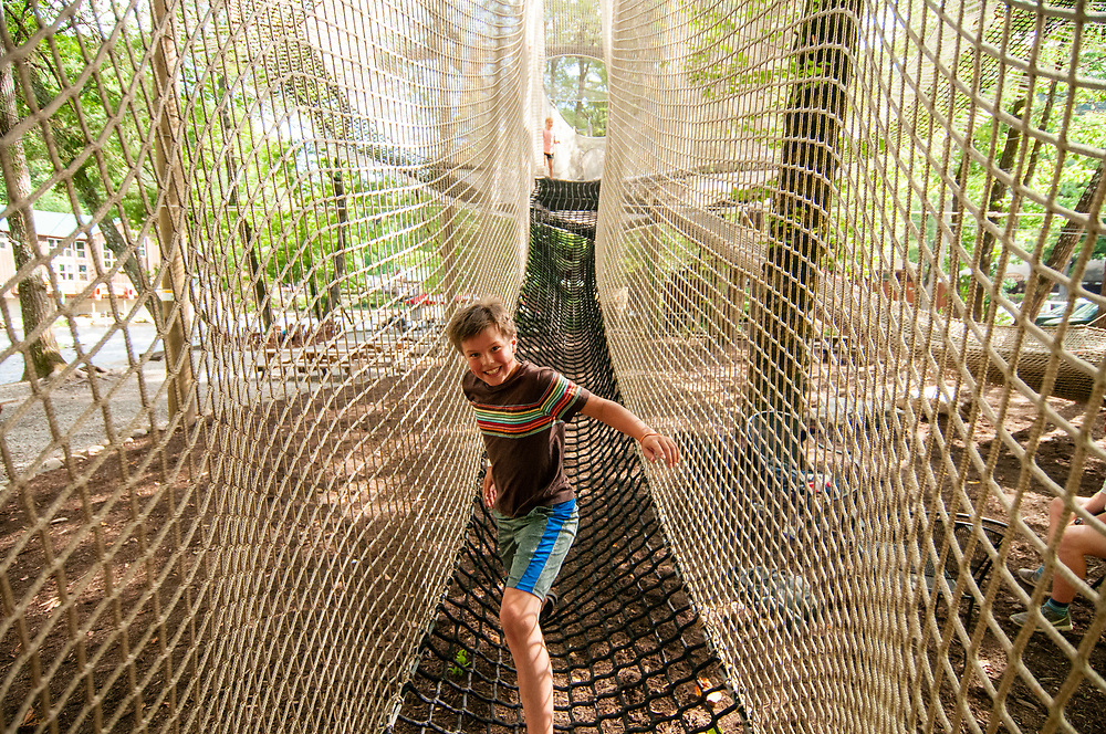 Children play on the ropes course at the Nantahala Outdoor Center in Bryson City, NC on Wednesday, June 28, 2017. Copyright 2017 Jason Barnette