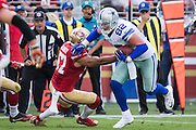 San Francisco 49ers inside linebacker Michael Wilhoite (57) tackles Dallas Cowboys tight end Jason Witten (82) at Levis Stadium in Santa Clara, Calif., on October 2, 2016. (Stan Olszewski/Special to S.F. Examiner)