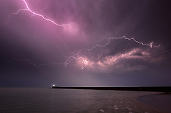 July 18, 2017 - Newhaven, East Sussex. 19th July 2017. Dramatic display of lightning over the English Channel as summer storms bring torrential rain to the South East. © Peter Cripps/Alamy Live News (Credit Image: © Cripps Photography/London News Pictures via ZUMA Wire)
