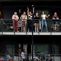 Fotball , 20. juni 2021 , Eliteserien , Mjøndalen - Strømsgodset 1-1<br /> illustrasjon ,fan , fans på privat tribune , veranda