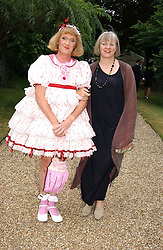 Left to right, artist GRAYSON PERRY and his wife PHILLIPPA at a fund raising event for The Galapagos Conservation Trust entitled 'Some Enchanted Evening' at the Chelsea Physic Garden Chelsea, London on 17th June 2004.