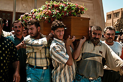 Family members mourn the loss of loved ones  in Baghdad, Iraq on Aug. 20, 2003. The previous day, the victim, who was a taxi driver was waiting for UN officials outside the building when a cement truck packed with explosives detonated outside the offices of the UN headquarters in Baghdad, Iraq, killing 20 people and devastating the facility in an unprecedented suicide attack against the world body. At least 100 people were wounded.