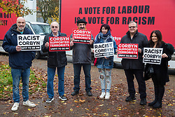 London, UK. 26 November, 2019. Activists from the Campaign Against Antisemitism protest outside the Bernie Grant Arts Centre in Tottenham before the arrival of Labour Party leader Jeremy Corbyn to launch Labour's new Race and Faith Manifesto.
