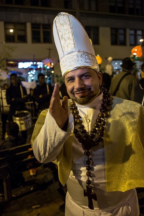 New York, NY - October 31, 2015. A clerical blessing from a marcher with Samba New York before the start of the Greenwich Village Halloween Parade.
