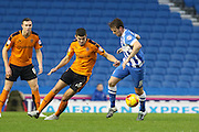 Wolverhampton Wanderers defender Danny Batth (6) pushes on Brighton central midfielder, Dale Stephens (6) during the Sky Bet Championship match between Brighton and Hove Albion and Wolverhampton Wanderers at the American Express Community Stadium, Brighton and Hove, England on 1 January 2016. Photo by Phil Duncan.