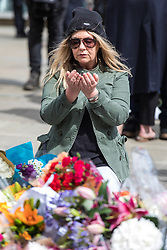 June 5, 2017 - London, London - London, UK. A woman prays as she lays flowers at London Bridge for those that lost their lives in the terrorist attack that took place on Saturday 3 June 2017. Three attackers drove a van at pedestrians before stabbing a number of people in nearby bars. (Credit Image: © Rob Pinney/London News Pictures via ZUMA Wire)