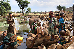 A family gathers water from a stream outside of Bahir Dar, Amhara Region, Ethiopia on May 23, 2007.
