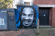 Street art portrait of local and much loved writer and poet Benjamin Zephaniah on 31st December 2020 in Birmingham, United Kingdom. Benjamin Obadiah Iqbal Zephaniah is a British writer, dub poet and Rastafarian. He was included in The Times list of Britains top 50 post-war writers in 2008.