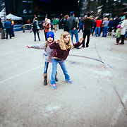 Girls play with hula hoops before the Michael Franti Concert in Teton Village at Jackson Hole Mountain Resort.
