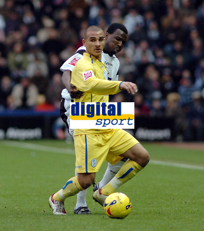 Photo: Kevin Poolman.<br />Derby County v Sheffield Wednesday. Coca Cola Championship. 13/01/2007. Marcus Tudgay of Wednesday comes under pressure from Derby's Mo Camara.