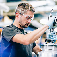 Industrial manufacturing at Gardner Denver in Redditich - engineers constructing machinery