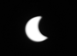 August 21, 2017 - Lawrenceburg, Indianna, USA - Lawrenceburg Indiana Solar Eclipse 2017--- The Sun and the Moon start to cross each other on Aug 21, 2017 in Lawrenceburg, Indiana over the Ohio River. (Credit Image: © Ernest Coleman via ZUMA Wire)