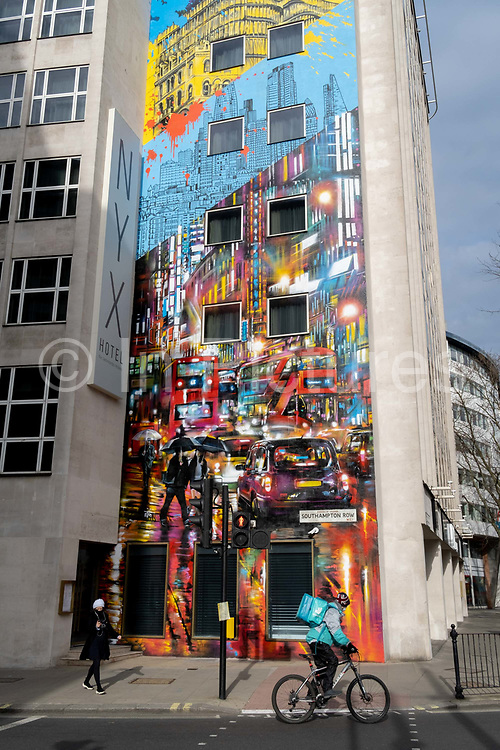 The mural that shows London in the rain, on the exterior of the NYX Hotel in Holborn which is due to open in May 2021, on 24th February 2021, in London, England.