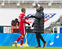 NEWCASTLE-UPON-TYNE, ENGLAND - Wednesday, December 30, 2020: Liverpool's manager Jürgen Klopp (R) and Thiago Alcantara after the FA Premier League match between Newcastle United FC and Liverpool FC at St. James' Park. The game ended in a goal-less draw. (Pic by David Rawcliffe/Propaganda)