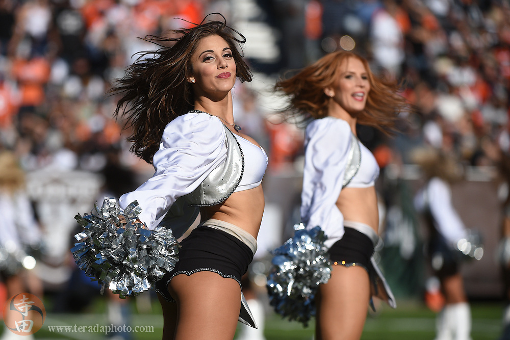 November 9, 2014; Oakland, CA, USA; Oakland Raiders Raiderettes cheerleaders Michelle (left) and Melanie (right) perform during the second quarter against the Denver Broncos at O.co Coliseum. The Broncos defeated the Raiders 41-17.