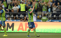 September 27, 2017 - Seattle, WASHINGTON, U.S - Sounders midfielder NICHOLAS LODEIRO (10) celebrates his goal against Vancouver as the Whitecaps visit the Seattle Sounders for an MLS match at Century Link Field in Seattle, WA. The Sounders won the match 3-0. (Credit Image: © Jeff Halstead via ZUMA Wire)