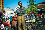 """PRICE CHAMBERS / NEWS&GUIDE<br /> Like he just stepped off the set of """"The Wild One,"""" Sean Duggan cuts a striking figure at the 49er Inn on Monday as he and a group of antique motorcycle riders stop for the evening during their cross-country ride called the Pre-1930 Motorcycle Cannonball. Duggan and his 1928 Harley Davidson JD join a pack of 50 dedicated riders in a two-week endurance run across the country from Newburgh, New York to San Francisco, Calif. """"I think a lot of the riders on this thing, they enjoy maintaining them as much as they like riding them,"""" Duggan said. """"This is  a special group."""""""