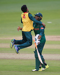 A team mate rushes to celebrate victory with Bangladesh's Mahmudullah after winning the ICC Champions Trophy, Group A match at Sophia Gardens, Cardiff.