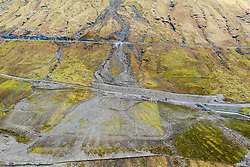 Glen Croe, Arrochar, Scotland, UK. 22 Feb 2021. Aerial view of landslide preventative engineering works to A83 at rest and be Thankful Pass in Glen Croe. The important route has been plagued by landslips which have often closed the main A83 carriageway forcing traffic to use the lower single track Old Military road below. Latest landslides have even blocked this road. Currently traffic is escorted one way in convoys. Pic;  General view showing extent of debris flow.   Iain Masterton/Alamy Live News