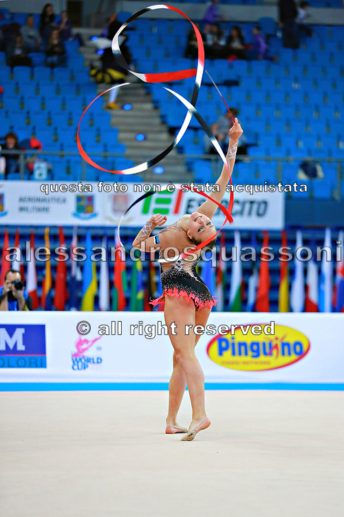 Bogdanova Olga during qualifying at ribbon in Pesaro World Cup 11 April 2015.<br /> Olga is an Estonian athlete born on december 24,1994 in Tallin.She has twin sister Viktoria has also represented Estonia in rhythmic gymnastics.