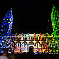 Viewers watch as Artistic lights illuminate the local cathedral during a light painting show at the Zsolnay Light Festival held in central Pecs, Hungary on June 30, 2018. ATTILA VOLGYI