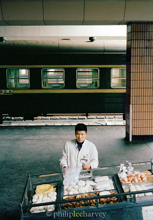 A food vendor at a railway station in China