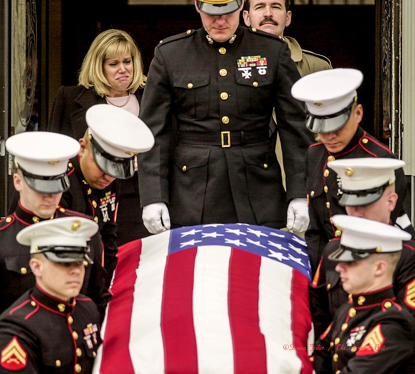 BETHLEHEM - The casket of Marine Corporal Kyle Grimes, 21, of Bethlehem is carried out of St. Anne's Catholic Church Friday afternoon, February 4, 2005. He was killed in a helicopter crash in Iraq. His mother MaryBeth LeVan of Baton Rouge, La., follows, upper left. Stepfather Steven LeVan of Baton Rouge is at upper right.     (DONNA FISHER/TMC)