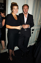 AMBER NUTTALL and SIMON MILLS at a party hosted by Ruinart Champagne at Claridges, Brook Street, London on 18th October 2006.<br /><br />NON EXCLUSIVE - WORLD RIGHTS