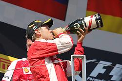 26.07.2015, Hungaroring, Budapest, HUN, FIA, Formel 1, Grand Prix von Ungarn, das Rennen, im Bild Sebastian Vettel (Scuderia Ferrari) trinkt aus der Sektflasche // during the race of the Hungarian Formula One Grand Prix at the Hungaroring in Budapest, Hungary on 2015/07/26. EXPA Pictures © 2015, PhotoCredit: EXPA/ Eibner-Pressefoto/ Bermel<br /> <br /> *****ATTENTION - OUT of GER*****