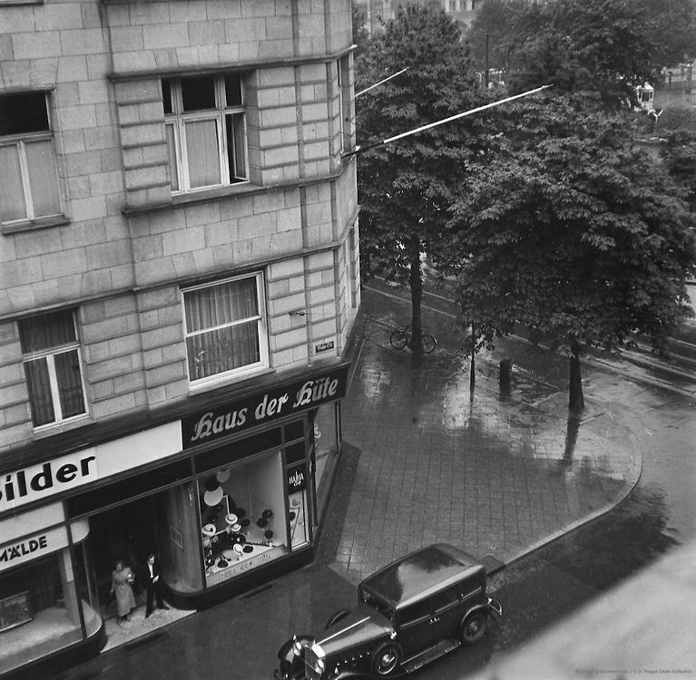 City Street During Rain, location unknown, Austria, 1937
