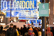 As the UK reacts to Prime Minister Boris Johnson's announcement of Lockdown 2 during the second wave of the Coronavirus pandemic, crowds of shoppers walk beneath Oxford Street's new Chistmas lights, on 2nd November 2020, in London, England. From midnight on Thursday, all non-essential shops, bars, restaurants and other small businesses will have to closed, according to government Covid restrictions - and for a minimum of 4 weeks in the run-up to Christmas.