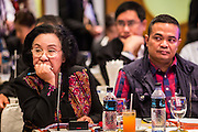15 DECEMBER 2013 - BANGKOK, THAILAND:  Dr. Thida Thavornseth (left) and Jutaporn Prompan, both core leaders of the United Front for Democracy Against Dictatorship (UDD also known as Red Shirts) during a forum on political reform in Thailand at the Queen Sirikit National Convention Center. The forum was organized by Thai Prime Minister Yingluck Shinawatra.      PHOTO BY JACK KURTZ