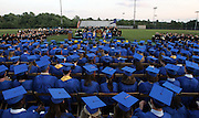 A sea of blue covered caps and gowns marked the 2006 graduating class of Western Albemarle High School Friday during the graduation ceremony held at the school. Photo/graduate celebrate happy