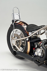 """A black with gold flames shovelhead built by """"Irish Rich"""" Ryan of Irish Rich Custom Cycles in Broomfield, CO. Photographed by Michael Lichter Boulder, CO on January 28, 2016. ©2016 Michael Lichter."""