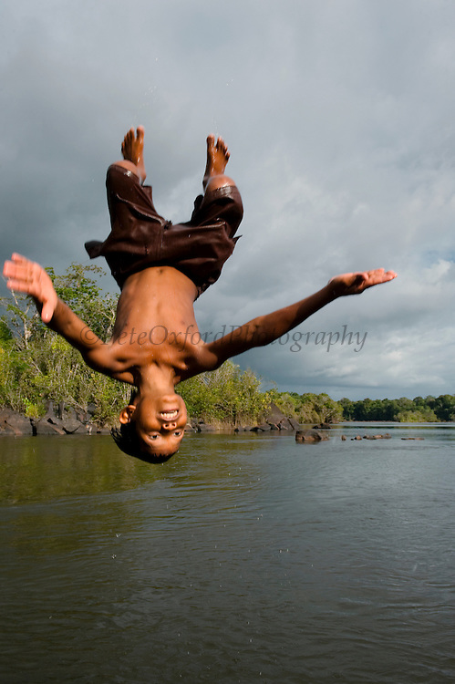 Children playing in River<br /> Essequibo River<br /> Iwokrama Forest Reserve<br /> GUYANA<br /> South America