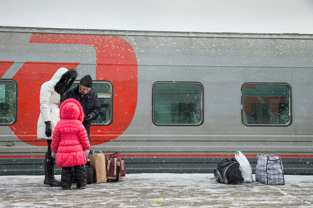 Passengers waiting on platform at Moscow train station. Russia