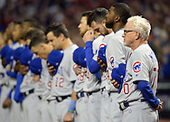 CLEVELAND, OH - OCTOBER 25: Joe Maddon and the Chicago Cubs observe the National Anthem prior to Game 1 of the 2016 World Series versus the Cleveland Indians at Progressive Field on Tuesday, October 25, 2016 in Cleveland, Ohio. (Photo by Ron Vesely/MLB Photos via Getty Images)