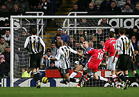 Photo: Andrew Unwin.<br /> Newcastle United v Charlton Athletic. The Barclays Premiership. 22/02/2006.<br /> Newcastle's Jean Alain Boumsong (#6) and goalkeeper, Shay Given, team-up to stop Charlton's Darren Bent (#10).