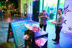 © Licensed to London News Pictures . 30/10/2016 . Manchester , UK . Two men eat chicken takeaway on Withy Grove . Revellers on a night out , many in fancy dress , on the weekend before Halloween . Photo credit : Joel Goodman/LNP