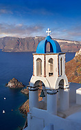 Bell tower of traditional blue domed Greek Orthodox church of Oia, Thira Island, Santorini Greece. .<br /> <br /> If you prefer to buy from our ALAMY PHOTO LIBRARY  Collection visit : https://www.alamy.com/portfolio/paul-williams-funkystock/santorini-greece.html<br /> <br /> Visit our PHOTO COLLECTIONS OF GREECE for more photos to download or buy as wall art prints https://funkystock.photoshelter.com/gallery-collection/Pictures-Images-of-Greece-Photos-of-Greek-Historic-Landmark-Sites/C0000w6e8OkknEb8