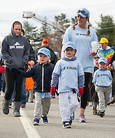 Jeffrey Joyce and Declan Perrino lead their Kiwanis T Ball team down North Main Street towards Colby Field for opening day ceremonies for Laconia Little League Saturday morning.  (Karen Bobotas/for the Laconia Daily Sun)