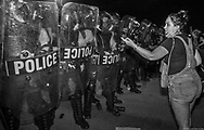Police in riot gear during a George Floyd solidarity protest  In New Orleans on June 3 stand in a line to meet thousands of people went on the Crescent City Connection to try to cross the bridge only to be teargassed by the police.