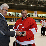 Fikri Atali, Turkey, receives the 'Best Player of the Team' award for the tournament from Kai Hietariinta, IIHF Tournament Chairman at the conclusion of the 2012 IIHF Ice Hockey World Championships Division 3 held at Dunedin Ice Stadium. Dunedin, Otago, New Zealand. 22nd January 2012. Photo Tim Clayton