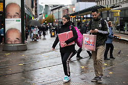 © Licensed to London News Pictures. 31/10/2020. Manchester, UK. The wet weather and tier 3 restrictions don't deter some people in Manchester today. Photo credit: Kerry Elsworth/LNP