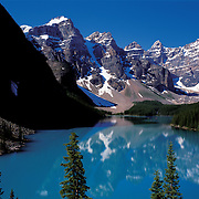 The mighty Canadian Rocky Mountains and the Valley of the Ten Peaks reflect in Morraine Lake in Banff National Park, Alberta, Canada.