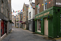 View of shops along deserted Commercial Street in old town of Lerwick, Shetland Isles, Scotland, UK