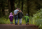 Thomas Norris and Chassidy Dewitt walk with their children Katie, left, and logan on Sept. 9, 2019 during a cross country meet at Ward Lake in Ketchikan, Alaska.